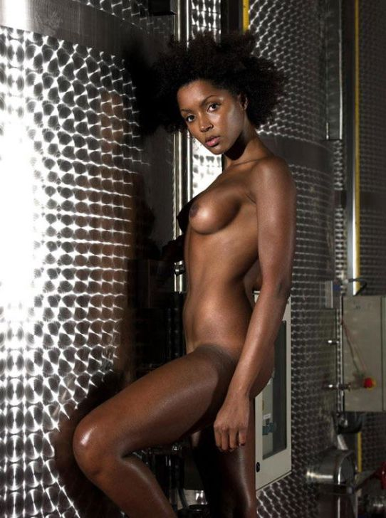 Well-lubed jet-black woman posing..