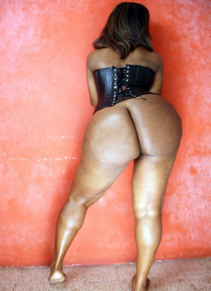 Dual elastic butts, dark-hued woman..