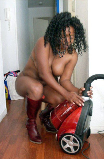 Mature ebony housewife with a vacuum..