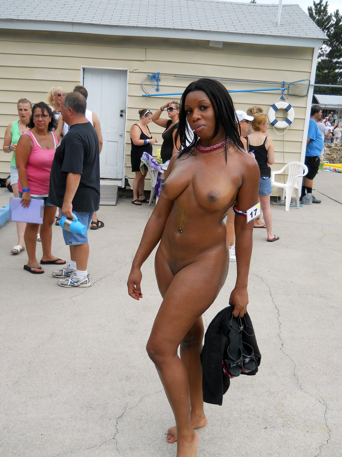 Flawless black bare plumper on beach..