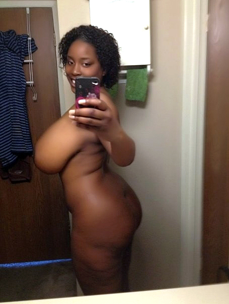 Naked intense ebony whore does  selfies