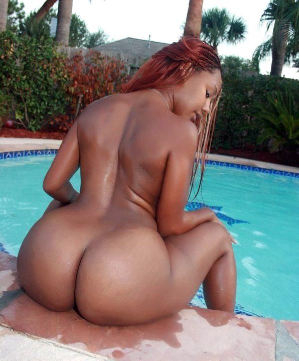 giant ebony bum in the swimming pool