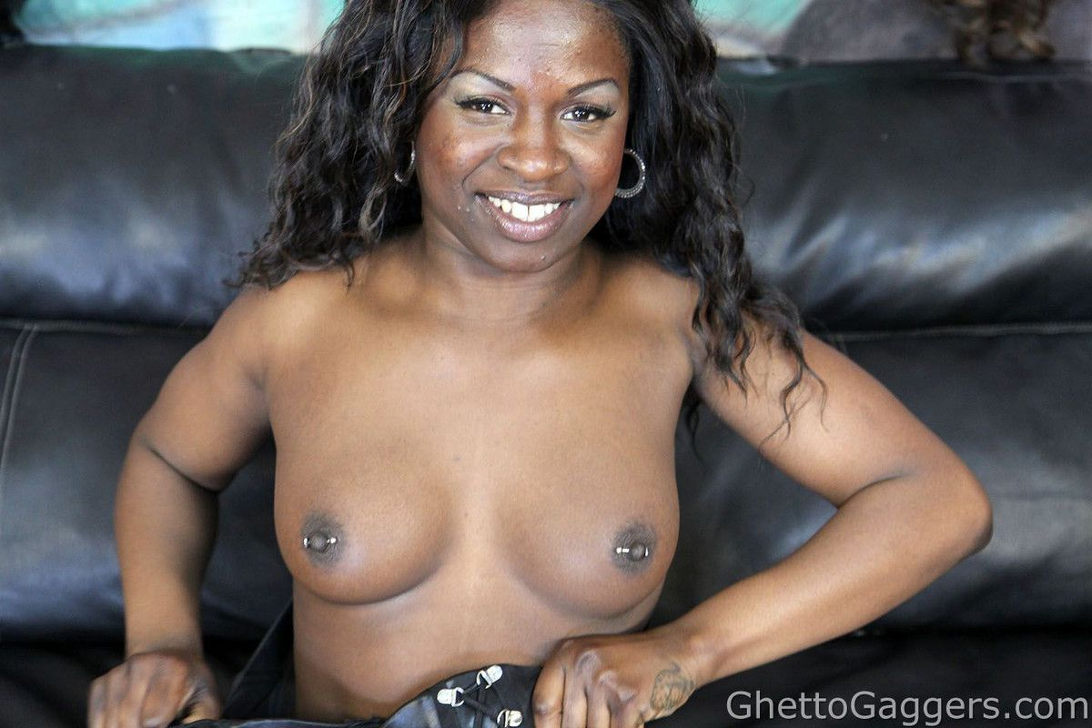 Stretches her enormous ebony cheeks