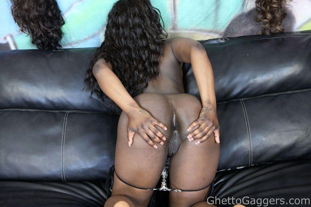 Opens up her phat dark-hued cheeks
